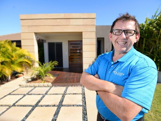 Real Estate agent Jason Rayner outside a Rockhampton house on the market for $699,000 which is a segment of the market said to be booming at the moment. Photo: Chris Ison / The Morning Bulletin