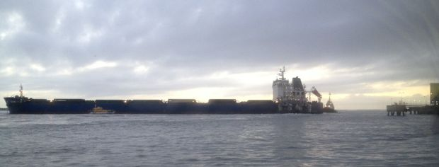 A ship has broken its moorings in Gladstone harbour this morning.