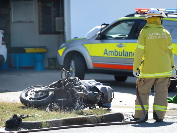 Emergency Services respond to an accident near the corner of Charles and Musgrave Streets involving a car and a motorcycle where the motorcyclist received serious burns. Photo: Chris Ison / The Morning Bulletin