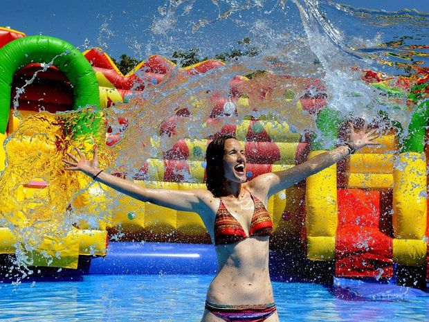 Water World's Alicia Klein enjoys splashing around ahead of the water park's opening this weekend.