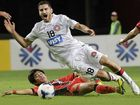 CUT DOWN: The Wanderers' Iacopo La Rocca is tackled by Lee Sang-hyeob.