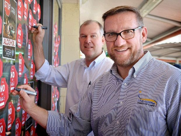 STOP IN THE NAME OF LIFE: Acting Mayor Tony Perrett and Gympie MP David Gibson sign on against the Fatal Five.