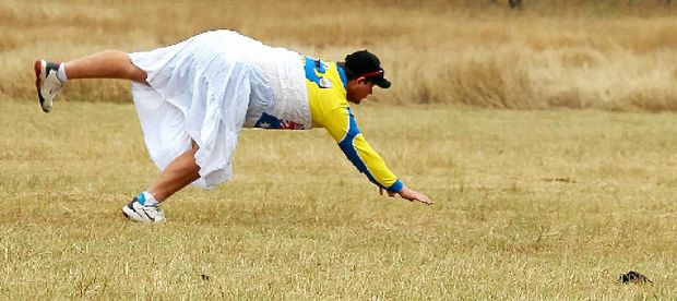 ASHES CLASHES: Action at the Reedybrook Ashes cricket carnival when a player dives in the outer not far from a cow pat.