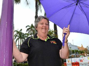 WELCOME WEATHER: Kerith Noy of Hamilton's Florists & Gifts was happy to see the rain falling in Mackay yesterday.