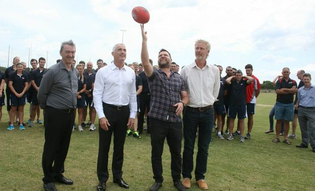 EYES ON THE BALL: At the Byron Regional Sport and Cultural Complex are l-r Byron Shire Council General Manager Ken Gainger, AFL Queensland CEO Michael Conlan, Pies fan and Byron Mayor Simon Richardson and vice-president of AFL Northern Rivers Juniors, Ean Jones.