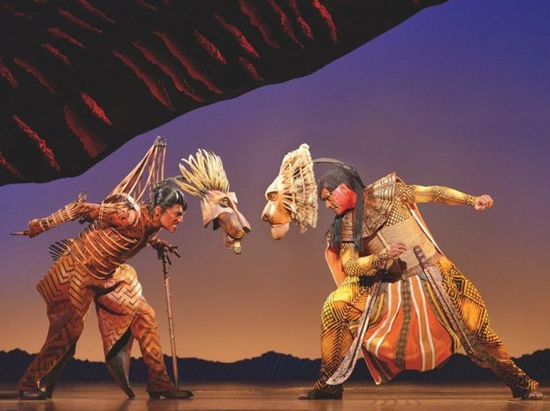 Rob Collins, left, as Scar and Josh Quong Tart as Mufasa in The Lion King.