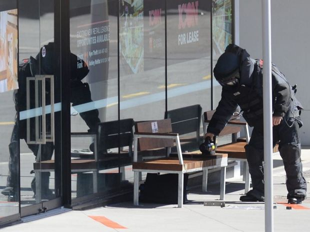 Police bomb squad inspects a suspicious package left under a seat in Bell Street on Monday morning. Photo: Rob Williams / The Queensland Times
