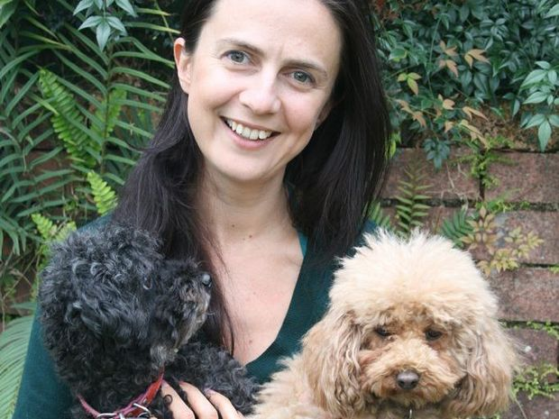 Animal protection advocate Anna Ludvik with two dogs rescued from puppy farms.