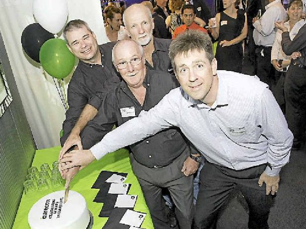 HAVING THEIR CAKE: Long-term employees Peter Smith, Jeff Hamelink, Jeff Worland and Rob Farnsworth celebrate Aurecon's 20 years in Gladstone at Scotties Bar and Restaurant on Friday night.