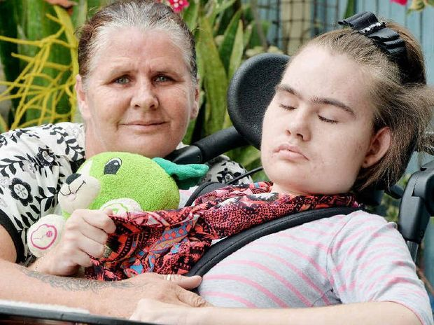 STAYING STRONG: Fiona McBain with her daugher Natasha, who suffers from the rare disorder, Rett Syndrome.