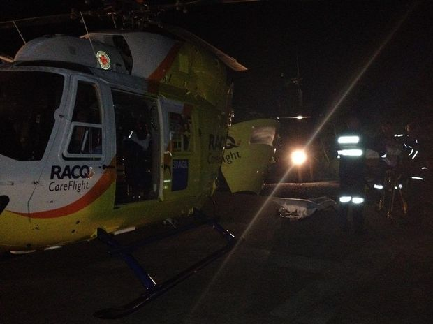 An RACQ CareFlight Rescue crew has flown to the aid of a 20-year-old woman who says she was bitten by a snake on Fraser Island.