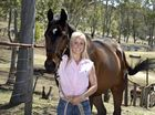 Toowoomba jockey Melody O'Brien with her retired thoroughbred gelding Professor Photo: Bev Lacey / The Chronicle
