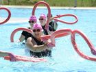 Ladies from Springfield's Waterworx water aerobics class perform the Pink Glove pool noodle dance as part of a breast cancer fundraiser on Friday morning. Photo: Rob Williams / The Queensland Times