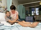 8 year old Oscar Root, bitten by a brown snake outside his home at Pechey, pictured with his mother Myola Root . Monday, Oct 20, 2014 . Photo Nev Madsen / The Chronicle