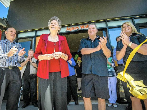 IN BUSINESS: Developer Geoff Bonney, long-time resident Betty Mergard, and Foodworks owners Peter Kinder and Michelle Irvine cut the ribbon.