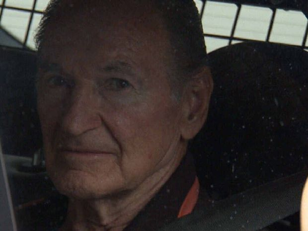 IN CUSTODY: Vince O'Dempsey in the back of a police vehicle heading into the Brisbane City watchhouse ahead of his court appearance today. Photo - Channel 9.