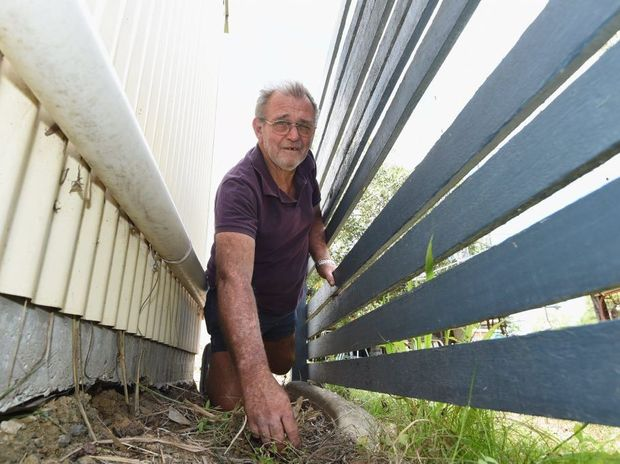 Mervyn Martin from Rockhampton was clearing down the side of his son's shed in Maryborough when he found a grenade.