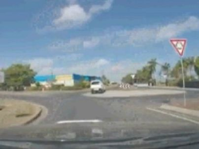 Car drives straight over Mackay roundabout.
