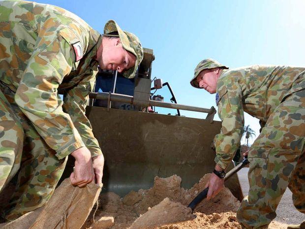 DIGGING IN: Army reservists Gibson Carragher and Tim Higgins load sandbags during a disaster response exercise at Byron Barracks in Lismore.