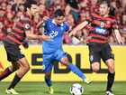 Al-Hilal's Salem Aldawsari is challenged by Western Sydney's Nikola Topor-Stanley and Mateo Poljak in the first leg of the AFC Champions League final in Sydney last week.