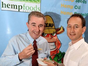LEGAL BATTLE: Kevin Hogan, Page MP, trying some Hemp seeds at Hemp Foods Australia warehouse in Bangalow, with CEO Paul Benhaim.