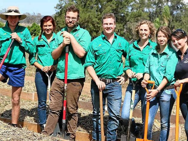 DIGGING DEEP: UQ students and UQ Gatton Plant Science Society members Ben Anderson Kirsty Neale, Edward Perry, James Feez, Noeleen Warman, Emily Pattison, Billie White and Katie Ferro are creating a community garden at the campus.