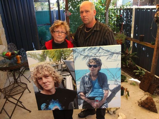 RIP SEAN: Bonnie and Brett Scovell from Biggenden with the canvas prints of their beloved son Sean who was tragically lost in a mining accident early in June in the garden they are creating to hold his ashes. Photo Rose Hamilton-Barr / Central & North Burnett Times