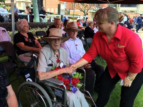 Second World War veteran Dennis Smith, 93, shakes hands with Mel Stephens at Maryborough's Remembrance Day service. Photo Robyne Cuerel / Fraser Coast Chronicle