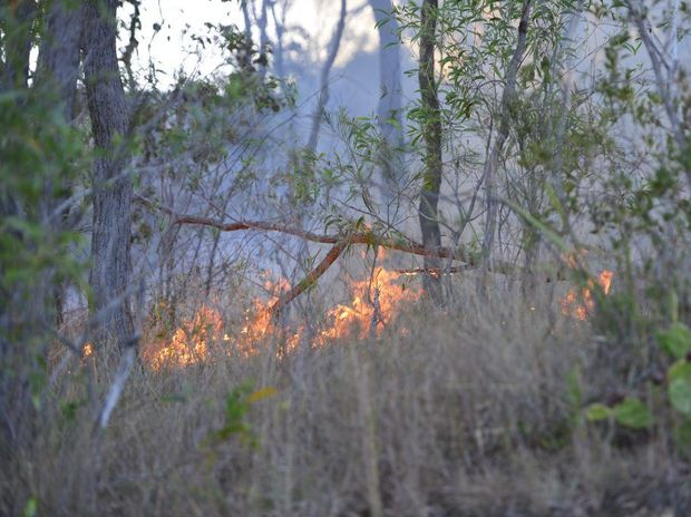 Three rural fire crews are fighting a fire near the Bruce Hwy.