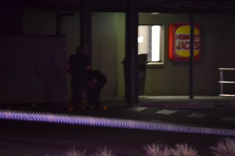 The Explosive Operations Response Team inspect the suspicious device left at Hungry Jacks, Booval.