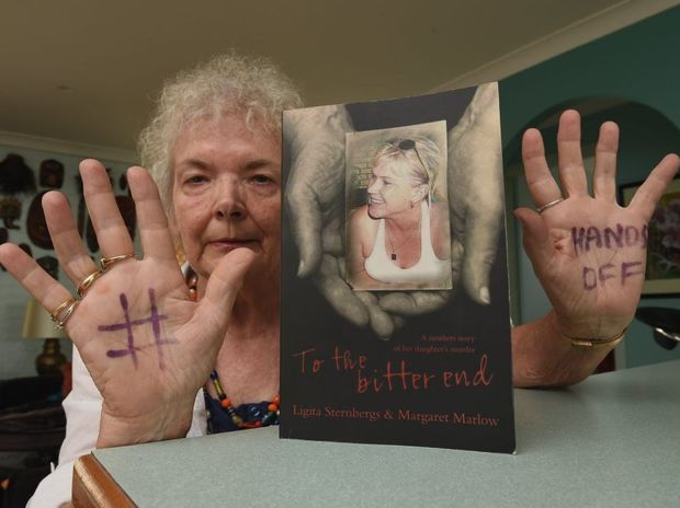 Ligita Sternbergs, with the the book she wrote about her daughter Ingrid Lester who was murdered, is supporting the Fraser Coast Chronicle's Hands Off campaign to reduce violence.