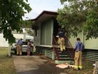 Firefighters at a home in Maryborough's Ambrose White St where an aerosol can exploded in a fire.