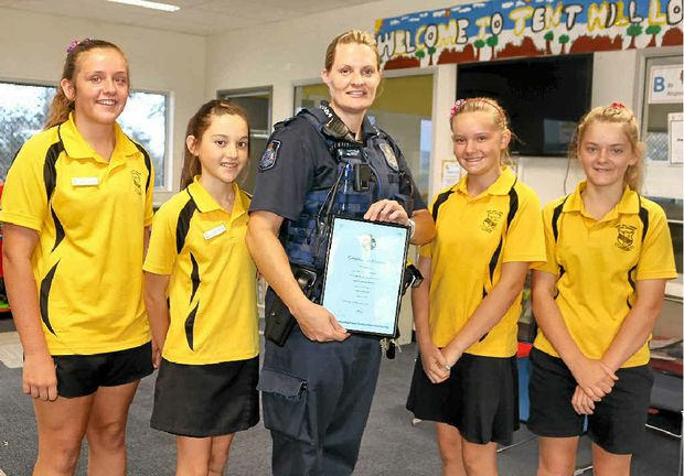 ADOPT-A-COP: Tent Hill Lower State School students Kyha Black, Chloe Hamblin, Alex Lindenmayer and Aerna Spierling welcome Constable Amber Belford to their school.