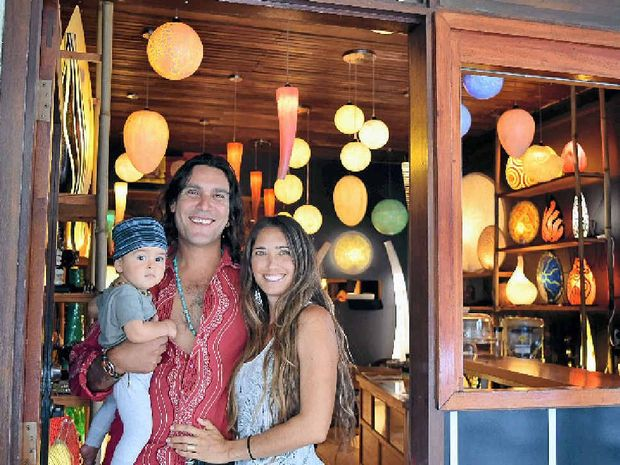 HAPPY MOVE: At their new Byron Bay Lighting shop on Jonson St is David, Tara and baby Kai Mizrahi.