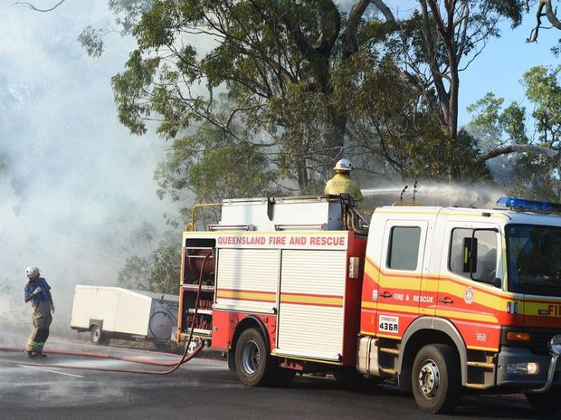 A bushfire on Torquay Tce was threatening a parked car and trailer beside the road.