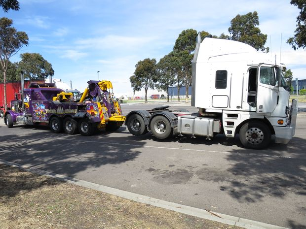 Police impound a truck in Victoria after a woman and child were found in the cab unrestrained.