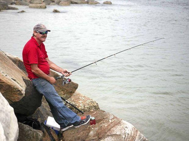 ROCKHOPPER: Brushgrove's Dan Bennett waits for a bite while fishing at the Yamba breakwall. PHOTO: BLAKE BODYCOTE