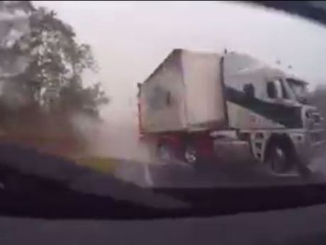 Judy Sokol's dash camera captures the moment a semitrailer slid across the Bruce Hwy and crashed into her four-wheel drive south of Maryborough.
