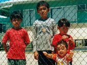 THE country's highest immigration official has contested allegations a five-year-old was raped on Nauru and lashed out at media reporting on the issue.