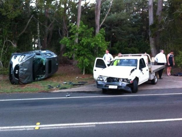 A car ended up on its side after two vehicles collided on Ramsay St at Middle Ridge.
