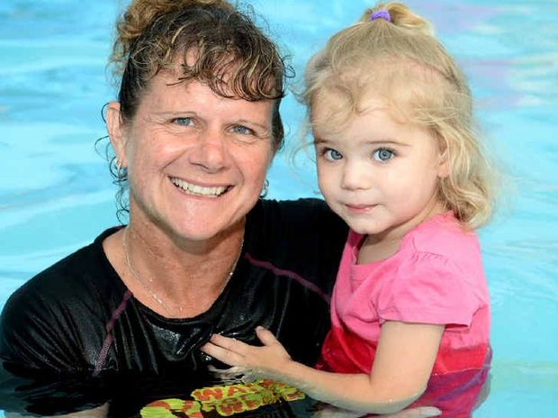 CLOSE CALL: Sandra MacBeth with two-year old Chloe Avenell who fell in a pool last week and swam to the edge.