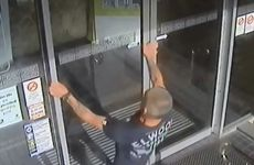 A man about to headbutt the glass door at the Villa Noosa Hotel. Photo: Queensland Police