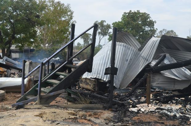 The remnants of a family home destroyed by fire in Condamine.