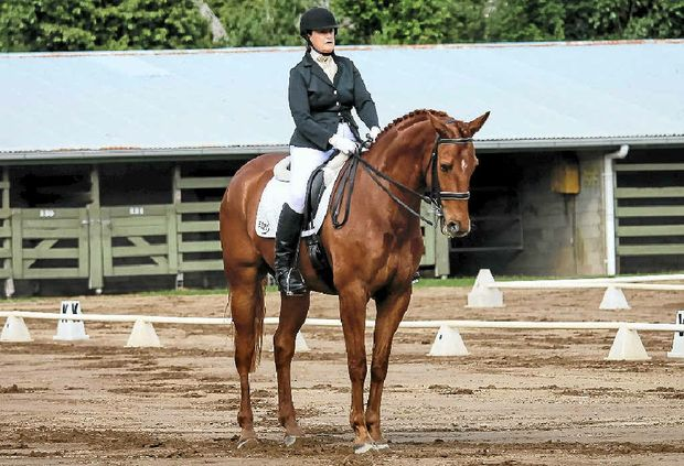 SUPERB EFFORT: Helidon equestrienne Lesleigh Kruse placed fourth with her horse Ambathala Cellini in the six-year-old Young Horse category at the Dressage Queensland Awards for 2014.
