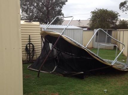 A family's trampoline was thrown over two 1.8m fences during a wild storm that hit Oakey this afternoon.