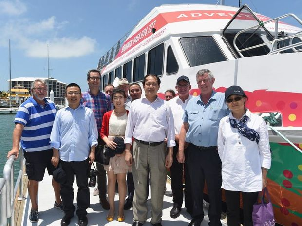 Chinese consul-general Zhao Yongchen (centre) with a trade delegation and locals at the Urangan harbour.