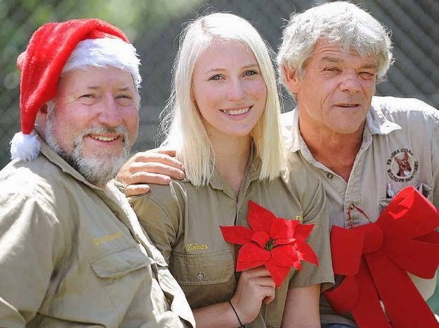 Zahra Chamberlain, the daughter of Michael and Ingrid Chamberlain, with Simon Stretton from Durong Dingo and Fraser Coast Wildlife Sanctuary curator Ray Revill.