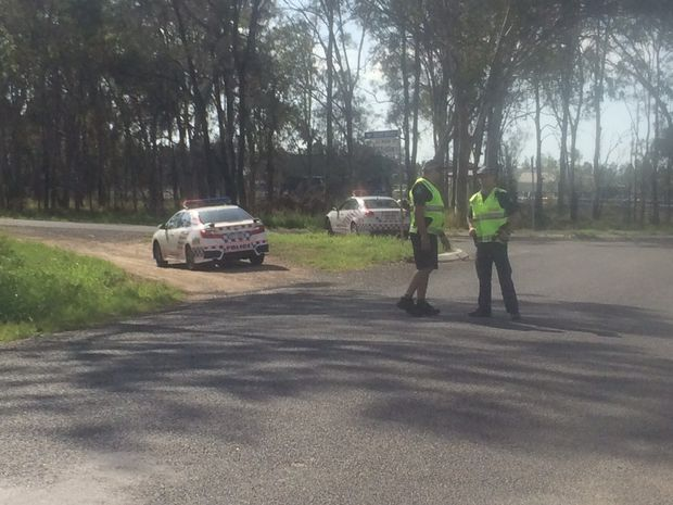 Scene at Burpengary where police search for a man.