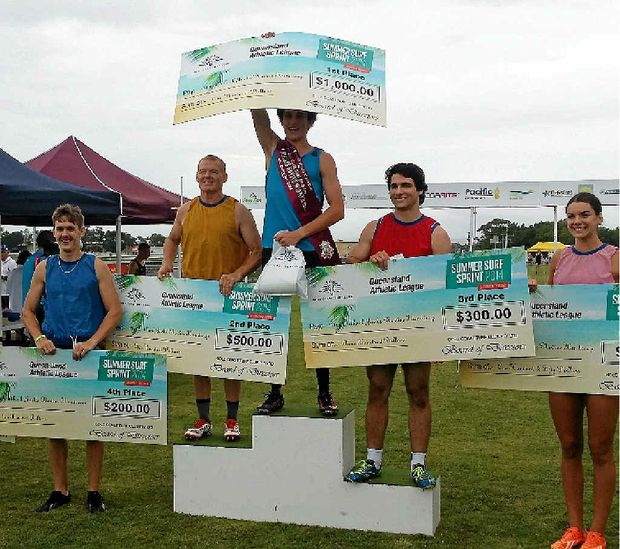 PROUD WIN: Lockyer Valley sprinter Leslie Snuderl raises his cheque in celebration following his win in the novice class at the coveted Gold Coast Turf Club Gift.