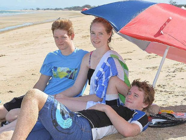 FAMILY TIME: Soaking up the sea air at Mackay Harbour Beach are, (from left) Braden Creber, Morgan Creber and Caleb Creber who came from Roma, complete with all the accessories, to spend the festive season with family in Mackay.